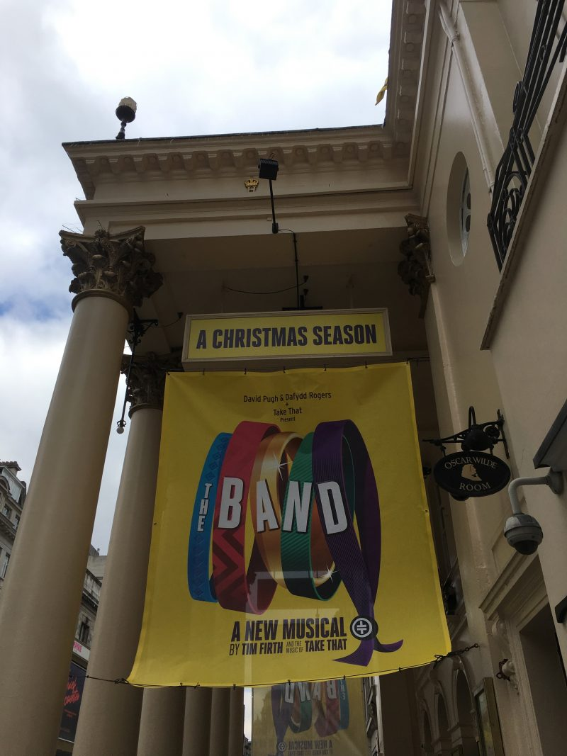 The Band advert outside the Theatre Royal Haymarket