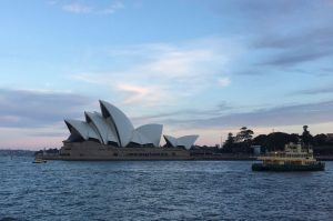 Ferry in front of the Sydney Opera House at sunset