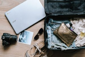 Holiday packing, suitcase and technology
