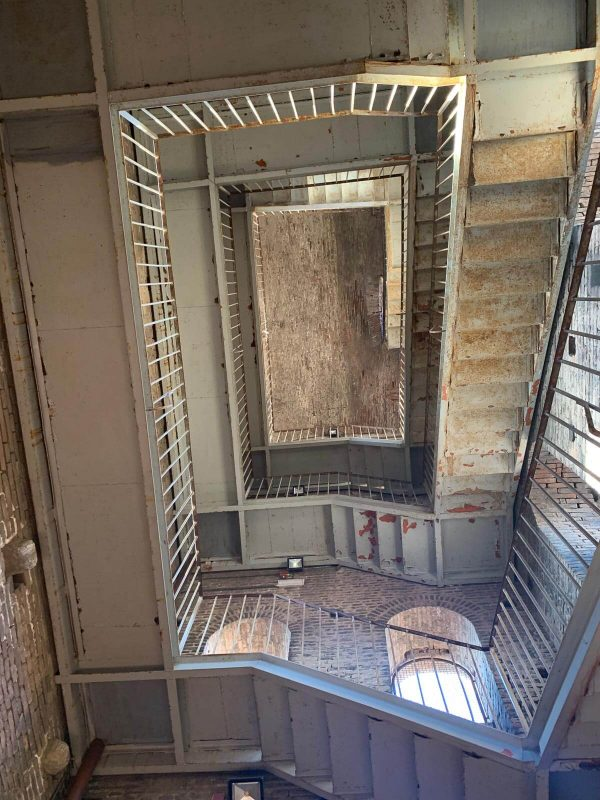 Looking up at the stairs around the inside of Panoramic view of Lucca and the top of the Torre Guinigi.