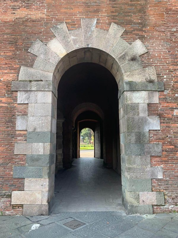 Looking through arch of pedestrian entrance on Lucca's city wall