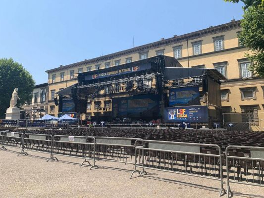 Piazza Napoleone being set with seating and stage for the Lucca Music Festival